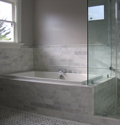 Tub & shower in white marble